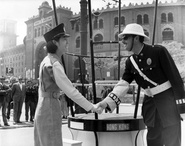 A Hong Kong Policewoman Shaking Hands With A Spanish