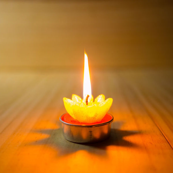 44876645 - burning candle in meditation placed on wooden floor