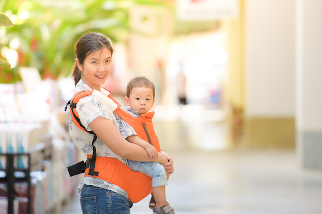 domestic helper in Hong Kong holding a baby